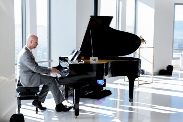 Jeremy playing piano at OUE Skyspace in DTLA.