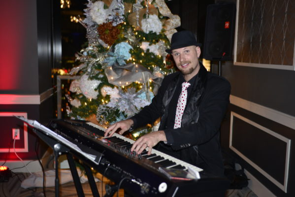 corporate holiday party keyboard player